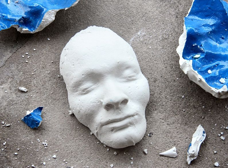 Face of a broken statue